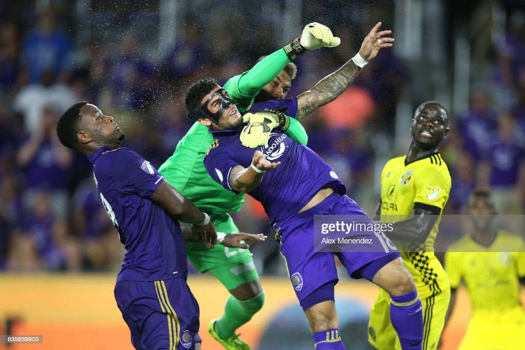 Dom Dwyer #18 of Orlando City SC collides with goalkeeper Zack Steffen #23 of Columbus Crew SC during a MLS soccer match between the Columbus Crew SC and the Orlando City SC at Orlando City Stadium on August 19, 2017 in Orlando, Florida.