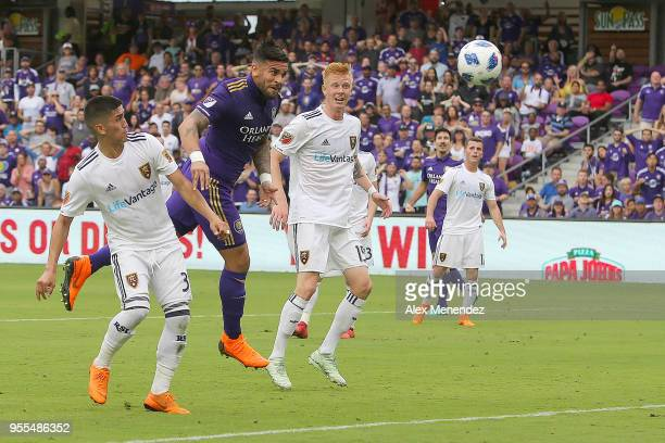 ORLANDO FL MAY 06 Dom Dwyer of Orlando City SC heads the ball into the net past Adam Henley of Real Salt Lake and Justen Glad of Real Salt Lake...