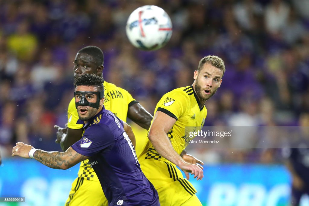 Dom Dwyer #18 of Orlando City SC looks at a through ball in front of Josh Williams #3 of Columbus Crew SC and Jonathan Mensah #4 of Columbus Crew SC during a MLS soccer match between the Columbus Crew SC and the Orlando City SC at Orlando City Stadium on August 19, 2017 in Orlando, Florida.