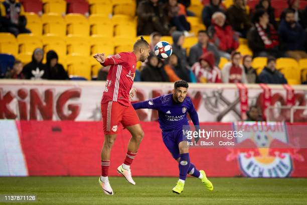 Dom Dwyer of Orlando City tries to field the header from Amro Tarek of New York Red Bulls during the MLS match between Orlando City SC and New York...