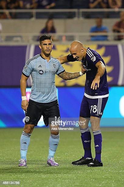 Dom Dwyer of Sporting Kansas City and Aurelien Collin of Orlando City SC push each other as they prepare for a corner kick during a MLS soccer match...