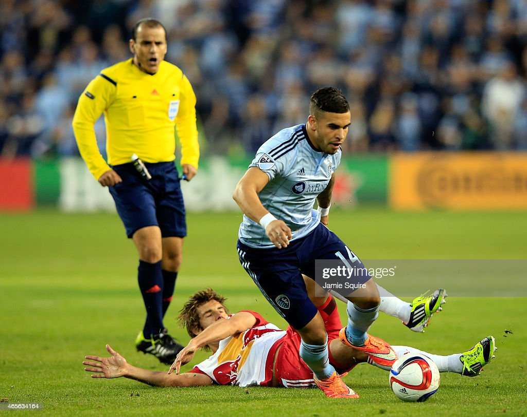 Dom Dwyer #14 of Sporting KC wins the ball from Damien Perrinelle #55 of New York Red Bulls during the game at Sporting Park on March 8, 2015 in Kansas City, Kansas.