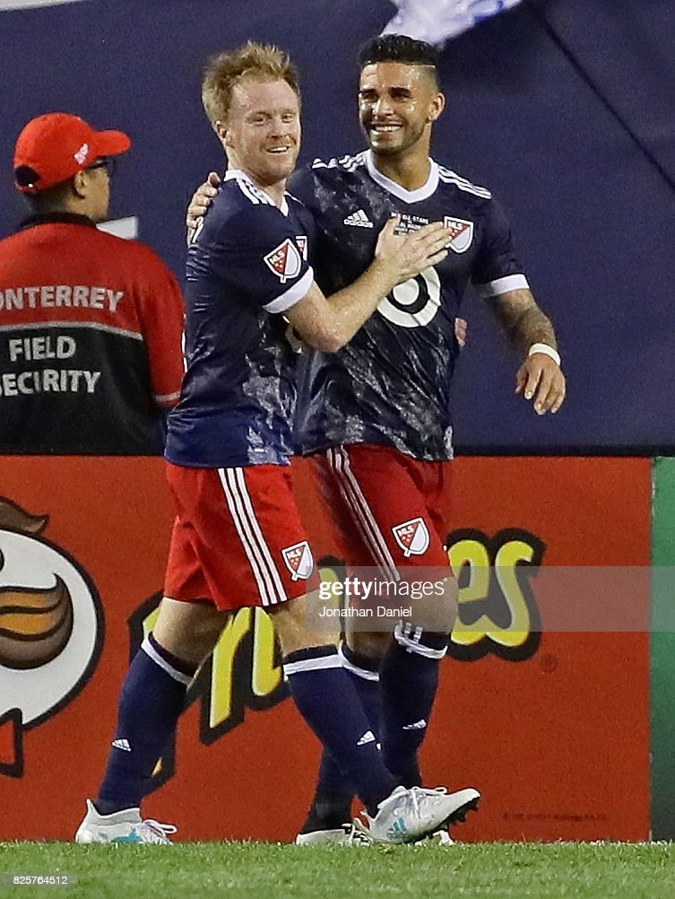 Dom Dwyer #14 of the MLS All-Stars (R) is congratulated by teammate Dax McCarty #6 after scoring a goal against Real Madrid during the 2017 MLS All- Star Game at Soldier Field on August 2, 2017 in Chicago, Illinois. Real Madrid defeated the MLS All-Stars 4-2 in a shootout following a 1-1 regulation tie.