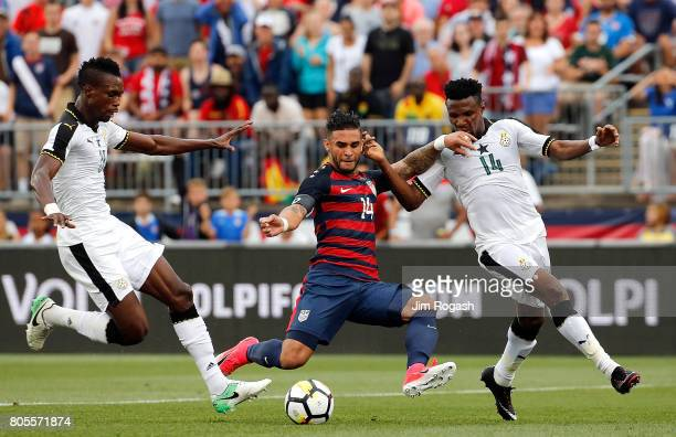 Dom Dwyer of the United States battles defenders John Boye and Jerry Akaminko of Ghana John Boye in the first half during an international friendly...