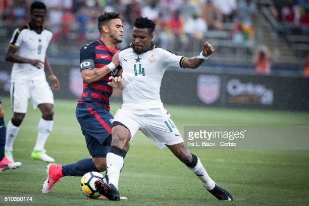 Dom Dwyer of US Men's National Team and Jerry Akaminko of the Ghana National Team fight for control of the ball during the International Friendly...