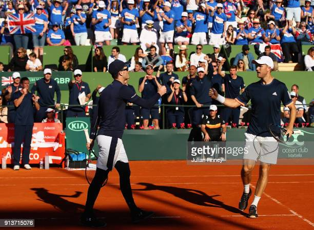 Dom Inglot and Jamie Murray of Great Britain in their match against Pablo Carreno Busta and Feliciano Lopez of Spain in the doubles during day two of...