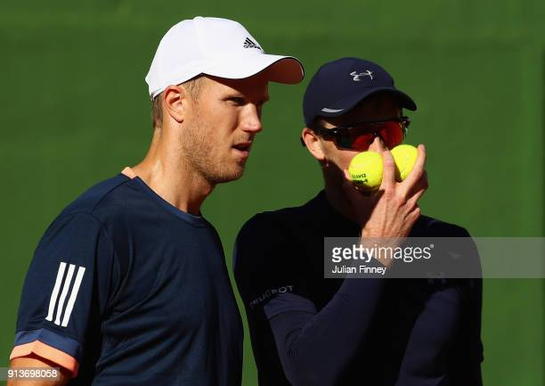 Dom Inglot and Jamie Murray of Great Britain talk tactics in their match against Pablo Carreno Busta and Feliciano Lopez of Spain in the doubles...