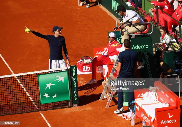 Dom Inglot and Jamie Murray of Great Britain talk with the umpire as they take on Pablo Carreno Busta and Feliciano Lopez of Spain in the doubles...