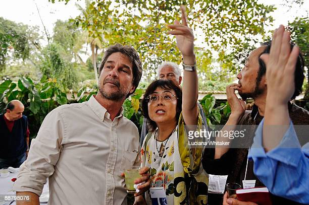 Dom Joao Henrique prince of Orleans e Braganca welcomes authors Xinran and Ma Jian during a lunch offered by him a Brazilian imperial family member...