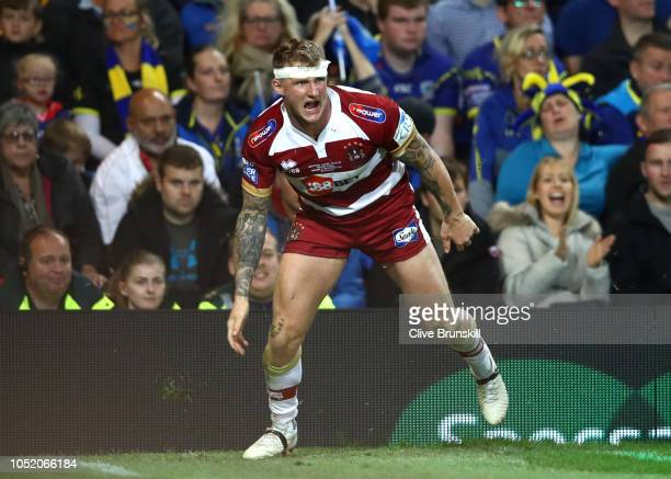 Dom Manfredi of Wigan Warriors celebrates after scoring his sides third try during the BetFred Super League Grand Final between Warrington Wolves and...