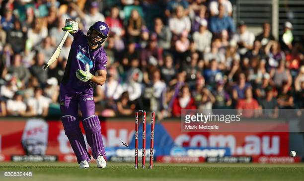 Dom Michael of the Hurricanes is bowled by Ben Hilfenhaus of the Stars during the Big Bash League match between the Hobart Hurricanes and Sydney...