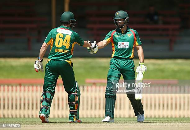 Dom Michael of the Tigers is congratulated by team mate Alex Doolan of the Tigers after scoring a half century during the Matador BBQs One Day Cup...