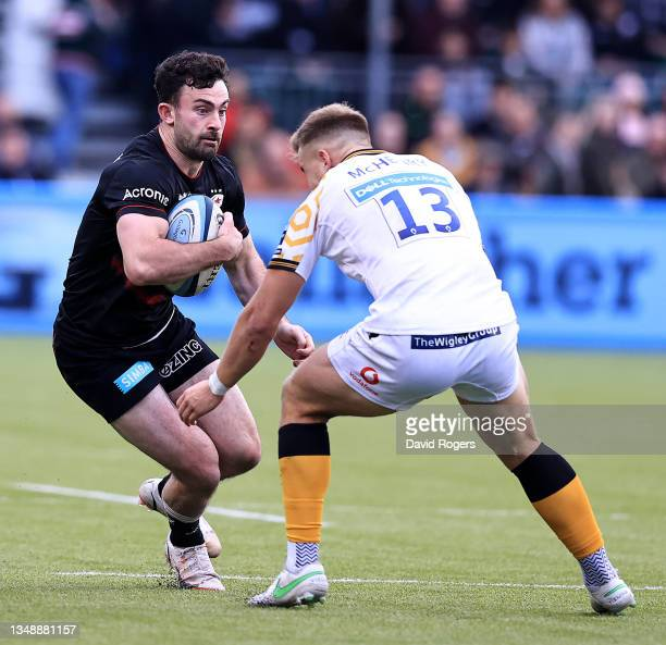 Dom Morris of Saracens taeks on Alex McHenry during the Gallagher Premiership Rugby match between Saracens and Wasps at StoneX Stadium on October 24,...