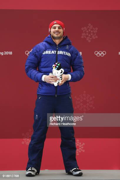 Dom Parsons of Great Britain celebrates finishing third during the Men's Skeleton at Olympic Sliding Centre on February 16, 2018 in Pyeongchang-gun,...