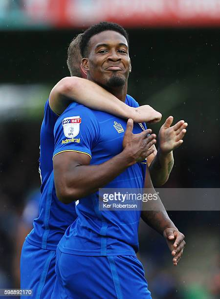 Dom Poleon of AFC Wimbledon celebrates scoring the winning goal in injury time with team mate Dean Parrett during the Sky Bet League One match...