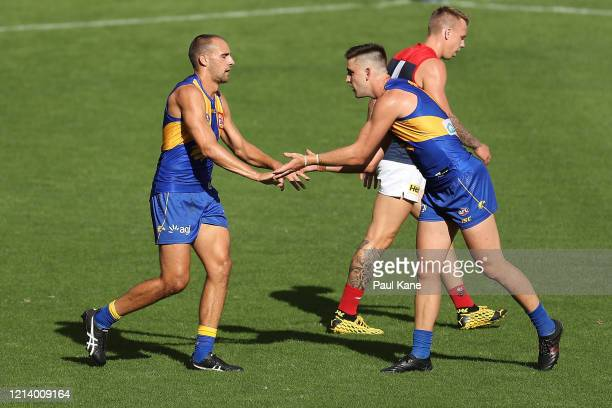 Dom Sheed and Elliot Yeo of the Eagles celebrate a goal during the round 1 AFL match between the West Coast Eagles and the Melbourne Demons at Optus...