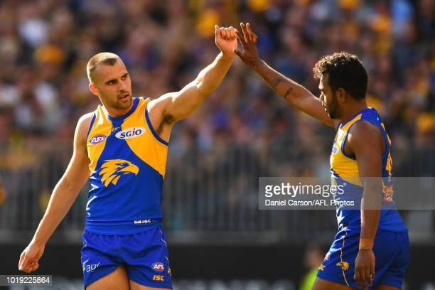 Dom Sheed and Willie Rioli of the Eagles celebrates a goal during the 2018 AFL round 22 match between the West Coast Eagles and the Melbourne Demons...