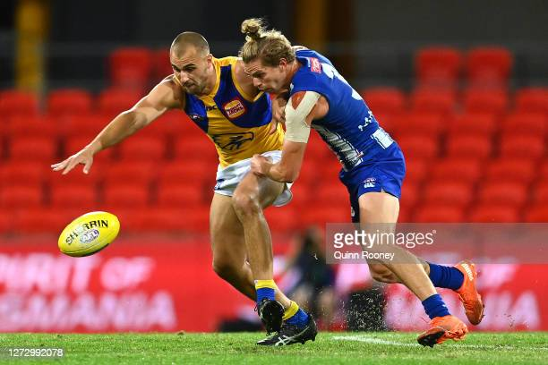 Dom Sheed of the Eagles and Jed Anderson of the Kangaroos compete for the ball during the round 18 AFL match between the North Melbourne Kangaroos...