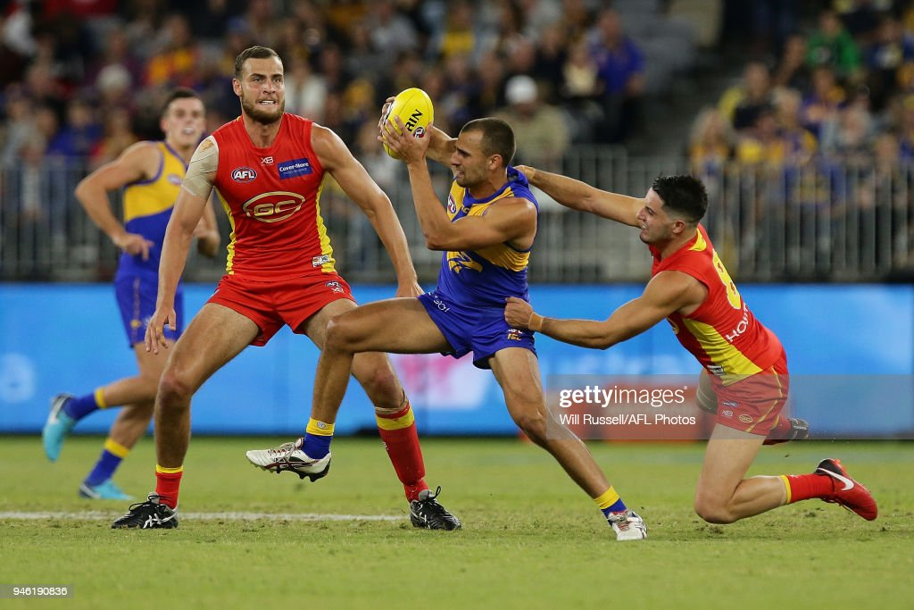 Dom Sheed of the Eagles is tackled by Brayden Fiorini of the Suns during the round four AFL match between the West Coast Eagles and the Gold Coast Suns at Optus Stadium on April 14, 2018 in Perth, Australia.