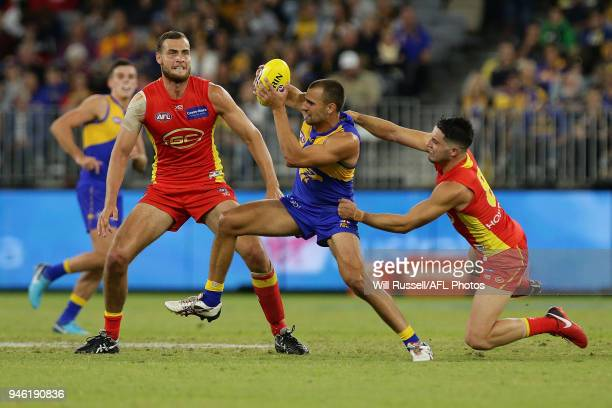 Dom Sheed of the Eagles is tackled by Brayden Fiorini of the Suns during the round four AFL match between the West Coast Eagles and the Gold Coast...
