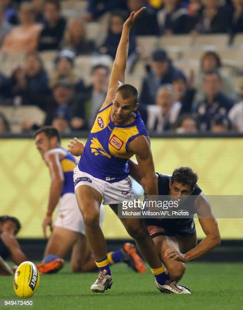 Dom Sheed of the Eagles is tackled by Ed Curnow of the Blues during the 2018 AFL round five match between the Carlton Blues and the West Coast Eagles...
