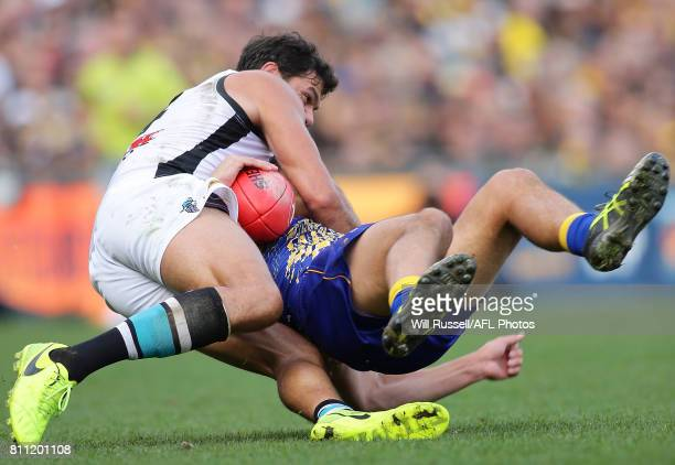 Dom Sheed of the Eagles is tackled by Paddy Ryder of the Power during the round 16 AFL match between the West Coast Eagles and the Port Adelaide...