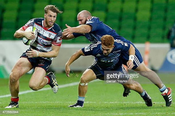 Dom Shipperley of the Rebels evades a tackle during the round 13 Super Rugby match between the Rebels and the Blues at AAMI Park on May 8 2015 in...