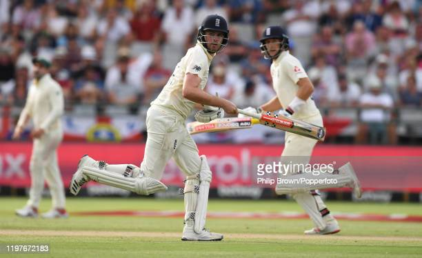 Dom Sibley and Joe Root of England run during Day Three of the Second Test between England and South Africa on January 05 2020 in Cape Town South...