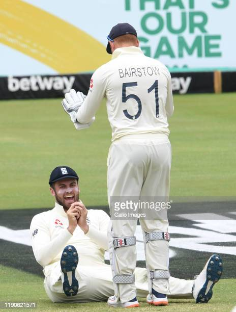Dom Sibley and Jonny Bairstow of England celebrate the wicket of Dwaine Pretorius of the Proteas during day 3 of the 1st Test match between South...