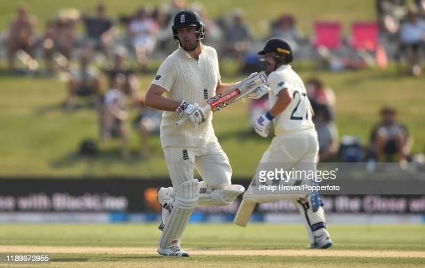 Dom Sibley and Rory Burns of England run during day four of the first Test match between New Zealand and England at Bay Oval on November 24 2019 in...