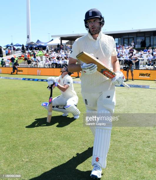 Dom Sibley and Rory Burns of England walk out to bat ahead of day one of the first Test match between New Zealand and England at Bay Oval on November...