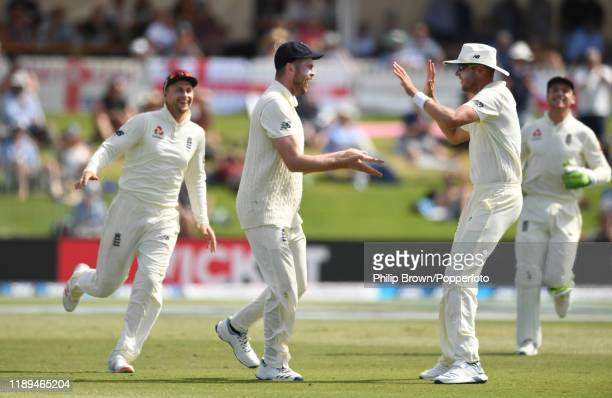 Dom Sibley and Stuart Broad of England celebrate the dismissal of Colin de Grandhomme during day three of the first Test match between New Zealand...