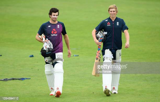 Dom Sibley and Zak Crawley of England walk to the nets during a nets session at Ageas Bowl on July 06, 2020 in Southampton, England.