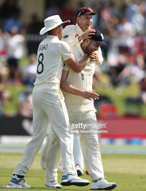 Dom Sibley is congratulated by Joe Root and Stuart Broad of England after catching Colin de Grandhomme during day three of the first Test match...