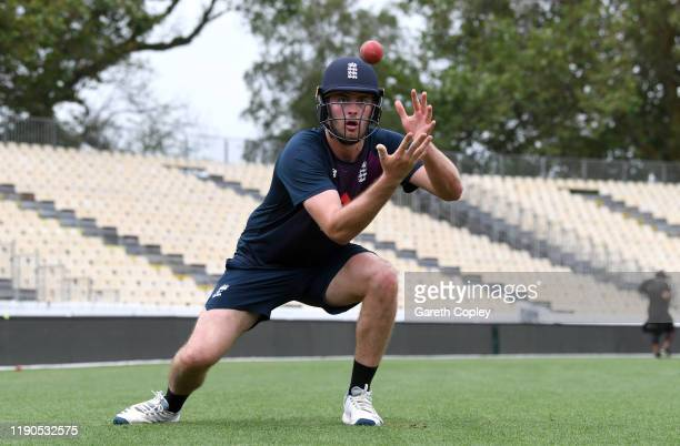Dom Sibley of England catches during the short leg fielding drill during a nets session at Seddon Park on November 28 2019 in Hamilton New Zealand