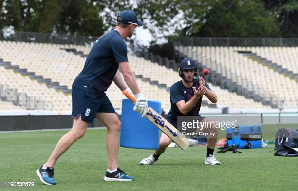 Dom Sibley of England catches during the short leg fielding drill with Paul Collingwood during a nets session at Seddon Park on November 28 2019 in...