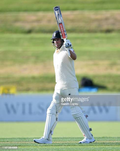 Dom Sibley of England celebrates reaching his century during the tour match between New Zealand XI and England at Cobham Oval on November 12 2019 in...