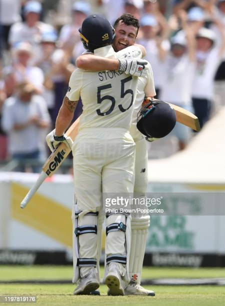 Dom Sibley of England celebrates with teammate Ben Stokes after reaching his century during Day Four of the Second Test between England and South...