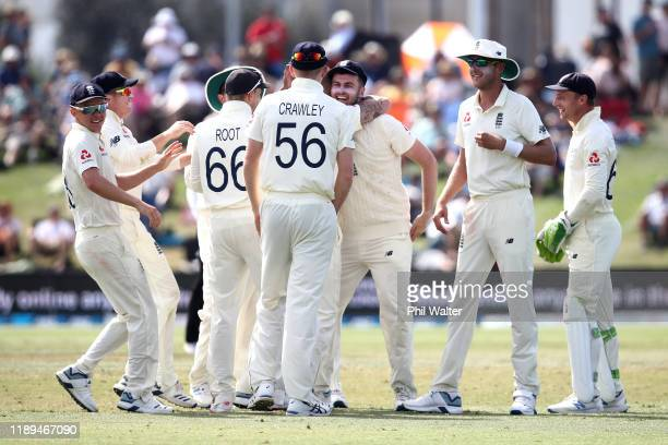 Dom Sibley of England is congratulated on his catch to dismiss Colin de Grandhomme of New Zealand during day three of the first Test match between...
