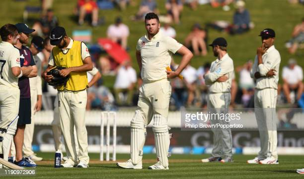 Dom Sibley of England on the field after being struck on the helmet by a Tim Southee delivery during day 2 of the second Test match between New...