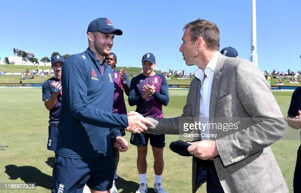 Dom Sibley of England receives his test cap from Michael Atherton ahead of day one of the first Test match between New Zealand and England at Bay...