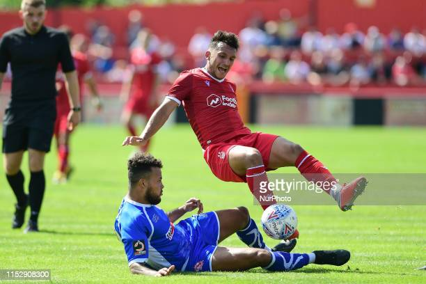 Dom Smith of Alfreton Town tackles Joao Carvalho of Nottingham Forest during the Pre-season Friendly match between Alfreton Town and Nottingham...
