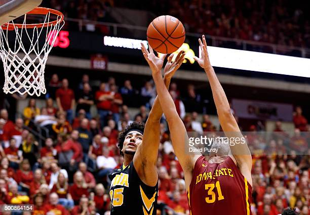 Dom Uhl of the Iowa Hawkeyes and Georges Niang of the Iowa State Cyclones battle for a rebound in the second half of play at Hilton Coliseum on...