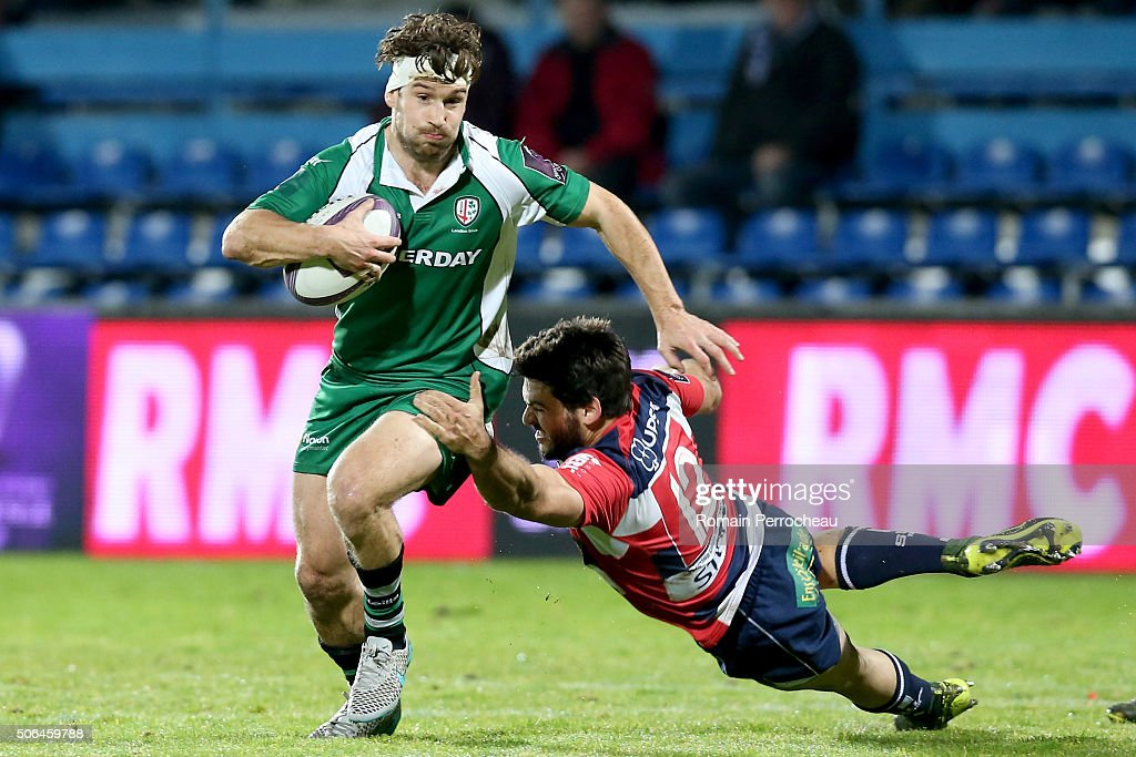 Dom Waldouck for London Irish is tackled by Julien Heriteau for Agen during the European Rugby Challenge Cup match between Agen and London rish at stade Armandie on January 23, 2016 in Agen, France..