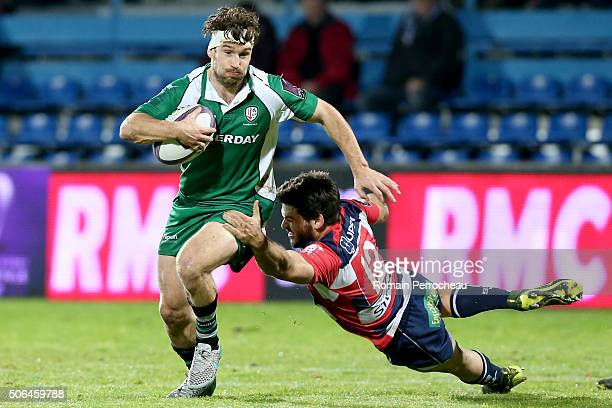 Dom Waldouck for London Irish is tackled by Julien Heriteau for Agen during the European Rugby Challenge Cup match between Agen and London rish at...