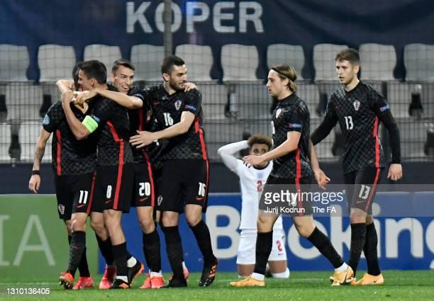 Domagoj Bradaric of Croatia celebrates with Nikola Moro, Petar Musa, Bartol Franjic, Lovro Majer and Mihael Zaper after scoring their side's first...