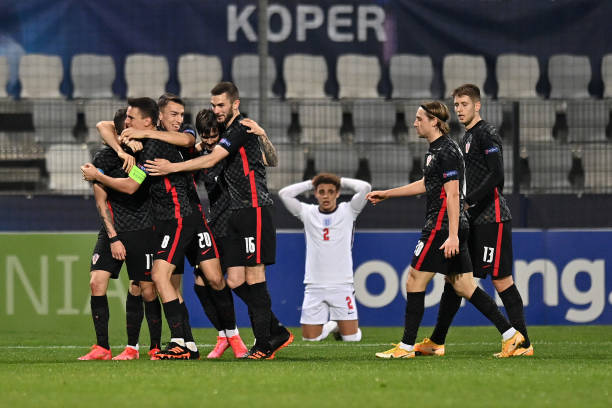 Domagoj Bradaric of Croatia celebrates with Nikola Moro, Petar Musa and teammates after scoring his team's first goal during the 2021 UEFA European...