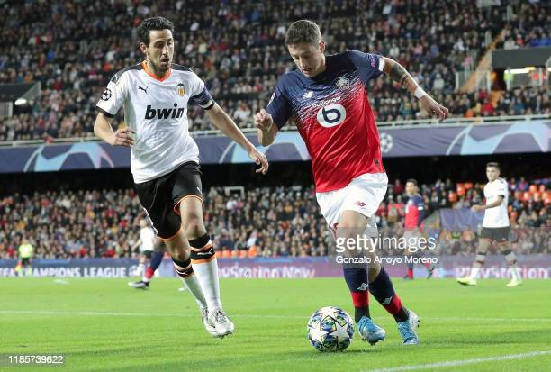 Domagoj Bradaric of Lille battles for possession with Daniel Parejo of Valencia during the UEFA Champions League group H match between Valencia CF...
