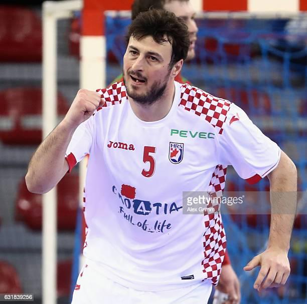 Domagoj Dunjak of Croatia celebrates a goal during the 25th IHF Men's World Championship 2017 match between Croatia and Belarus at Kindarena on...