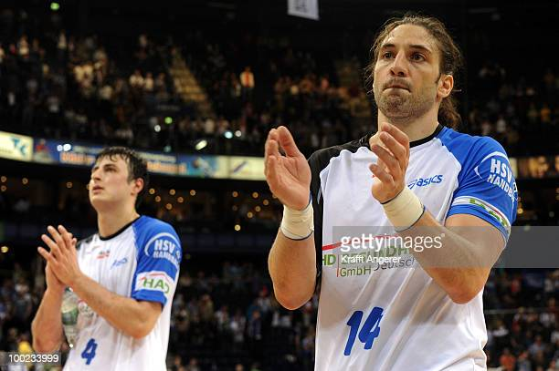 Domagoj Duvnjak and Bertrand Gille of Hamburg react after the Bundesliga match between HSV Hamburg and THW Kiel at the Color Line Arena on May 22,...